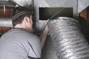 Worker Installing Heating